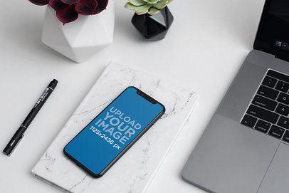 Mockup of an iPhone 11 Pro on an Elegant Office Desk 2122-el1