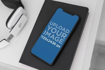 Mockup Featuring an iPhone 11 Pro Placed by a Headset 2154-el1