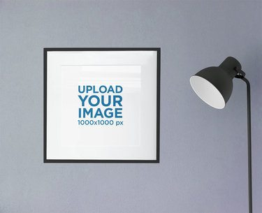 Minimal Mockup Featuring a Square Poster Frame Hanging by a Lamp 2020-el1