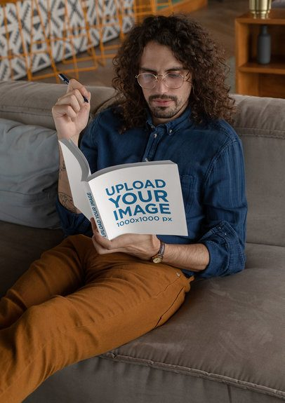 Square Book Mockup Featuring a Long-Haired Man Reading on a Couch 30920