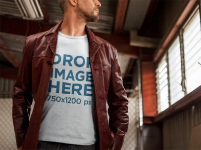 Mature Man Wearing a T-Shirt Mockup in an Urban Setting a9376