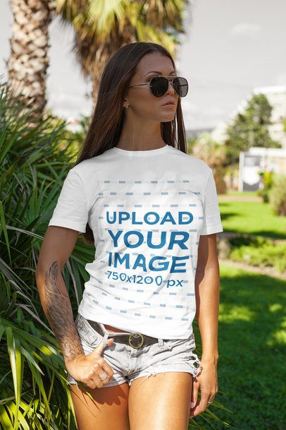 T-Shirt Mockup of a Stylish Tattooed Woman at a Park 2264-el1