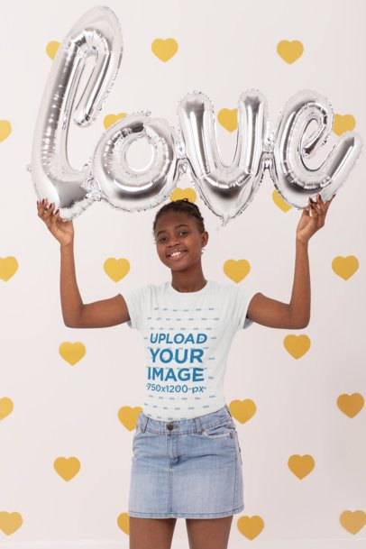 T-Shirt Mockup of a Young Woman Holding Foil Letter Balloons Spelling Love 31212