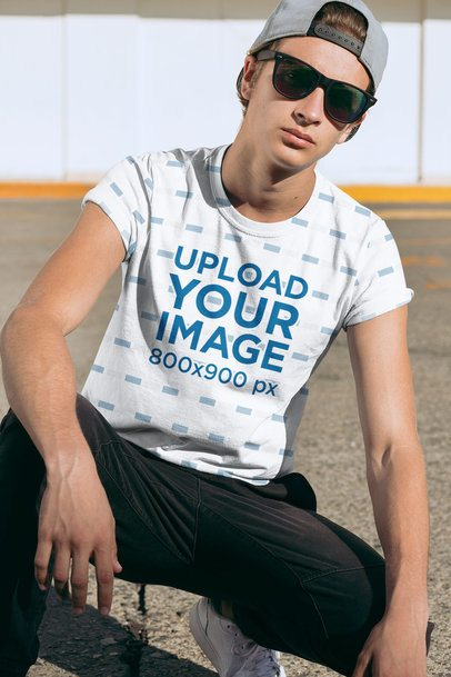 Sublimated T-Shirt Mockup Featuring a Young Man with Sunglasses 31114