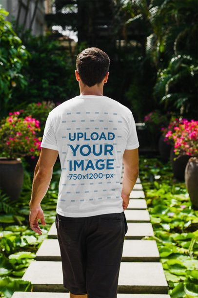 Back View T-Shirt Mockup of a Man Walking Through a Tropical Hallway 2255-el1
