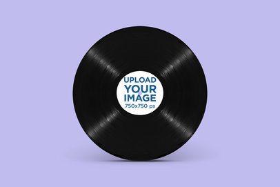 Minimal Mockup Featuring a Vinyl Record Standing Against a Solid Color Backdrop 2346-el1