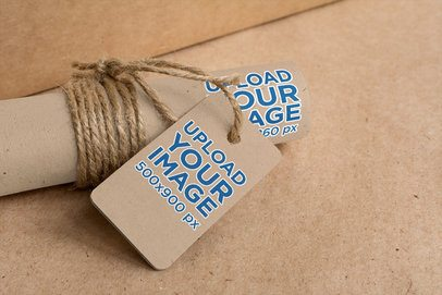 Mockup of a Brand Tag Placed on a Craft Wrapping Paper Roll 1295-el1