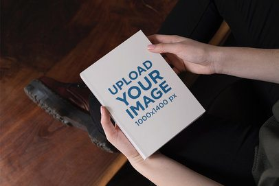 Mockup of a Woman Holding a Hardcover Book in Her Hands 2353-el1