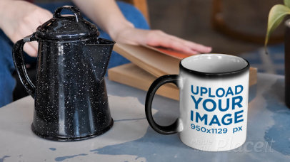Video Featuring a Woman Pouring Coffee into an 11 oz Magic Mug Placed Next to a Book 331573