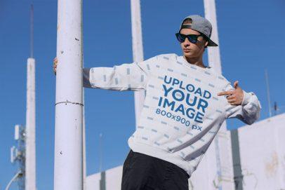 Sublimated Crewneck Sweatshirt Mockup Featuring a Man at an Urban Environment 31124
