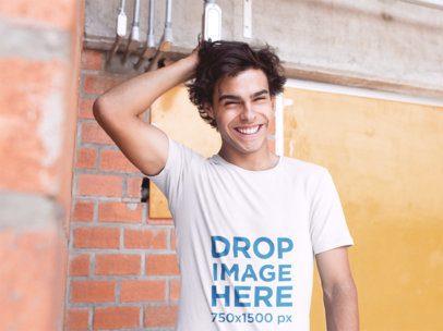 T-Shirt Mockup of a Guy Smiling and Grabbing His Hair a11594