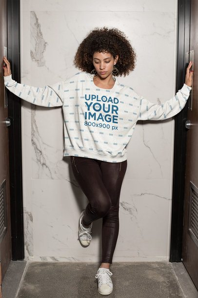 Sublimated Sweatshirt Mockup Featuring a Woman Standing Between Two Doors 31159