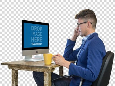 PNG iMac Mockup Featuring a Working Man Wearing Glasses a11728