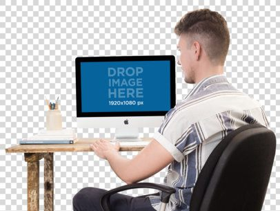 PNG iMac Mockup of a Man Typing on his iMac a11724