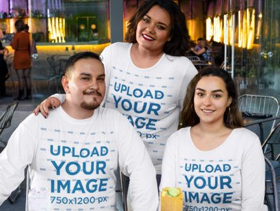 Plus Size Long-Sleeve Tee Mockup Featuring a Group of Three People at a Restaurant 31062