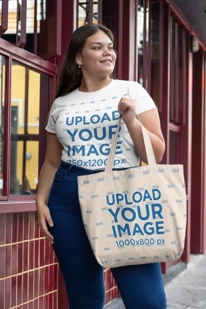 Plus Size Mockup Featuring a Woman with a T-Shirt and a Sublimated Tote Bag 30906