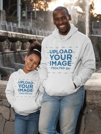 Mockup of a Dad and His Daughter Wearing Pullover Hoodies 31398