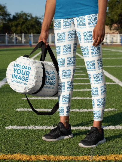 Duffle Bag Mockup Featuring a Woman Wearing Leggings 31348
