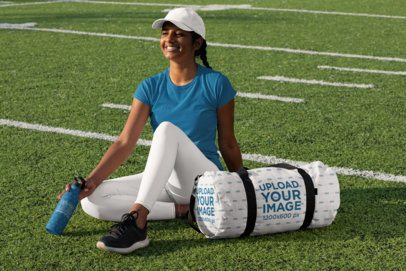 Duffle Bag Mockup Featuring a Young Woman Holding an Aluminum Bottle 31351