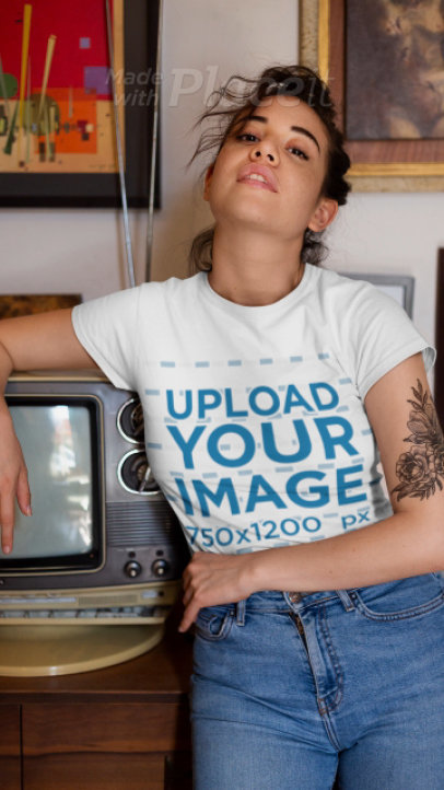 T-Shirt Video Featuring a Tattooed Woman Posing by a Retro TV 22468
