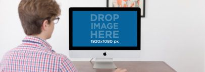 Mockup of a Boy Studying on His iMac at Home a11783