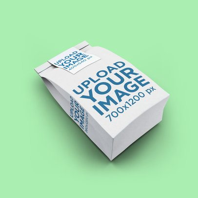 Mockup of a Paper Bag Lying on a Solid Color Surface 2584-el1