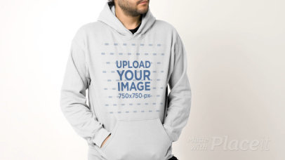 Pullover Hoodie Video Featuring a Young Bearded Man at a Studio 32030