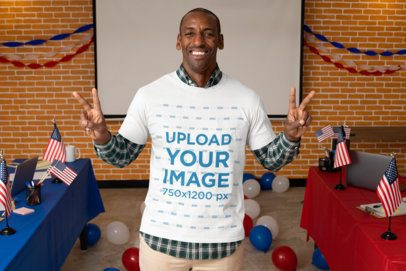 T-Shirt Mockup of a Happy Man at a Polling Place 31934