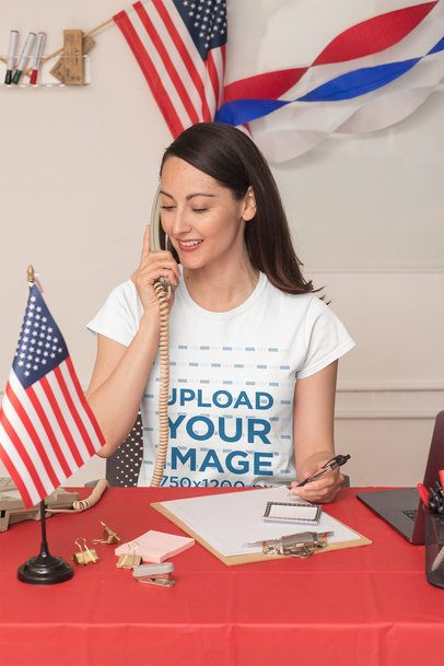 T-Shirt Mockup Featuring a Woman in a Political Polling Station 31913