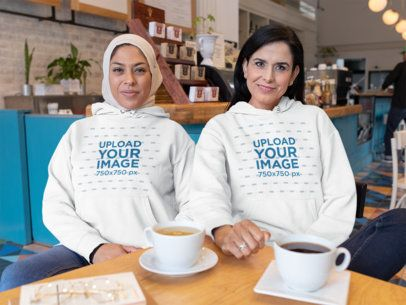Hoodie Mockup Featuring Two Women Hanging Out at a Coffee Shop 32074