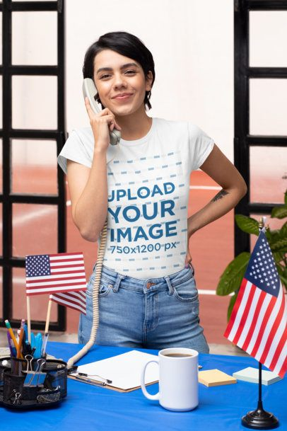 T-Shirt Mockup Featuring a Woman on the Phone in a Political Polling Station 31943