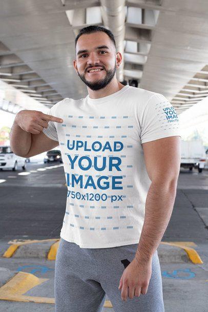 Mockup of a Muscled Man Pointing at His T-Shirt 31477