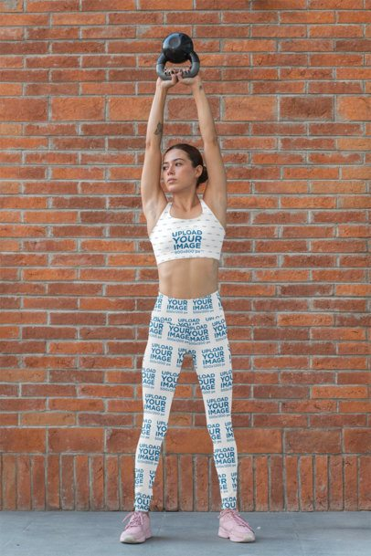 Sports Bra Mockup of a Woman with Sublimated Leggings Lifting a Weight 31499