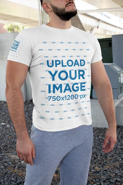 Mockup of a Strong Man Wearing a T-Shirt with Front and Sleeves Prints 31478
