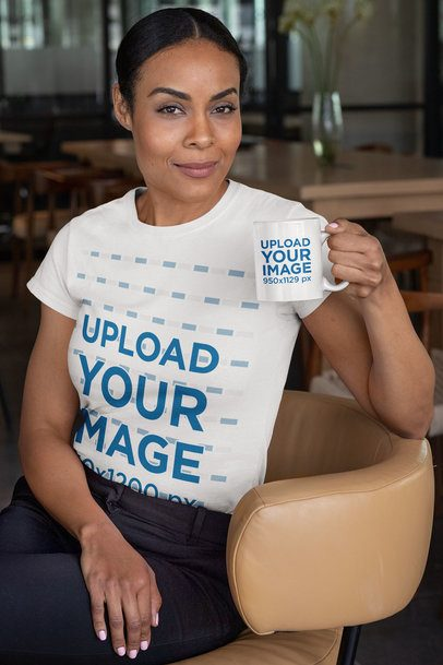 T-Shirt Mockup of a Woman Sitting on a Chair Holding an 11 oz Coffee Mug 31705