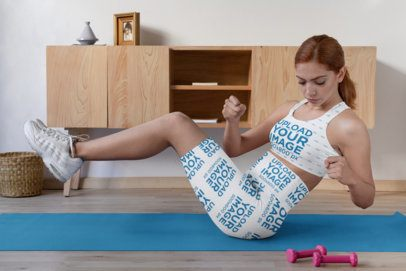 Sports Bra Mockup of a Woman Wearing Sports Shorts While Working out at Home 31522