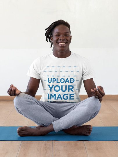 T-Shirt Mockup of a Man Doing the Lotus Position 31106