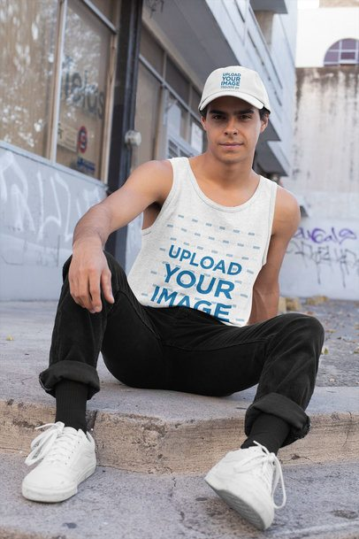 Tank Top Mockup Featuring a Man with a Dad Hat Posing in an Urban Environment 31175