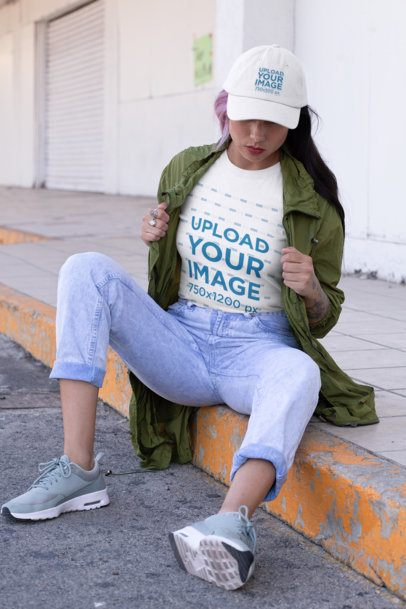 T-Shirt Mockup of a Woman Wearing a Dad Hat in an Urban Setting 31194