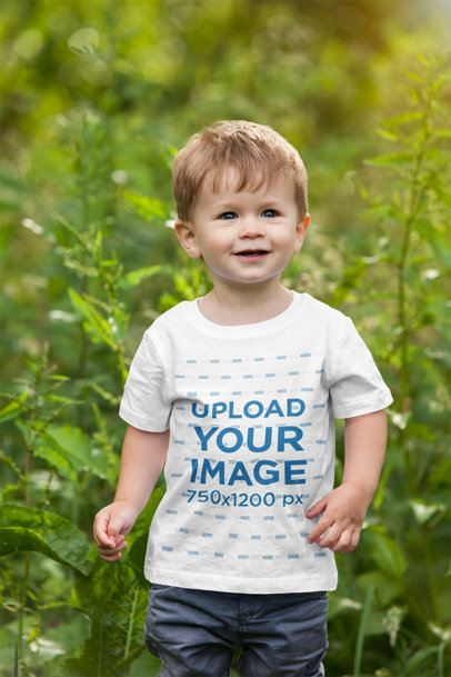 Mockup of a Toddler Wearing a T-Shirt and Walking in Nature 2915-el1