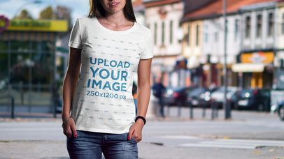T-Short Mockup Featuring a Woman and a City in the Background 2986-el1