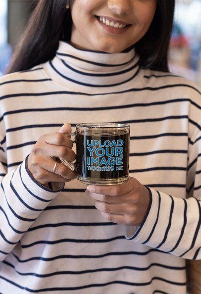 Mockup of a Smiling Woman Holding a Glass Coffee Mug 31740