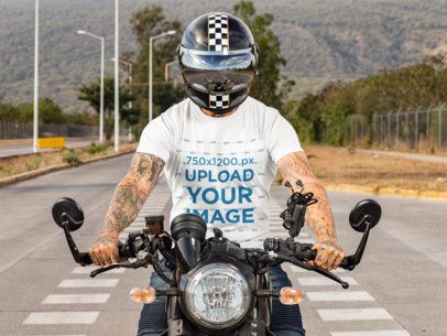 T-Shirt Mockup of a Tattooed Man Riding His Motorcycle 31788