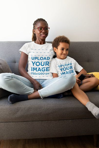 T-Shirt Mockup Featuring a Mom and Her Son Sitting in the Living Room 32651