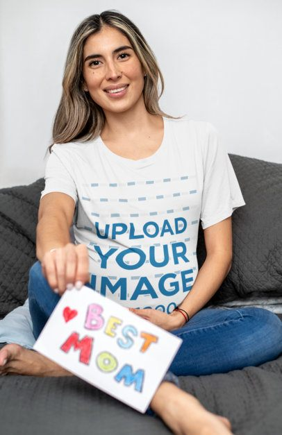 T-Shirt Mockup Featuring a Pregnant Woman Sitting on a Couch 32247