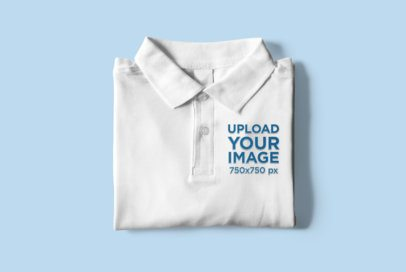 Mockup of a Folded Polo Shirt Placed on a Customizable Surface 3090-el1