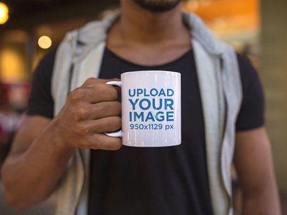 Young Man Holding a Coffee Mug Mockup a12299