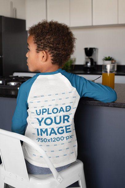 Back-View Raglan T-Shirt Mockup of a Boy Eating Breakfast 31645