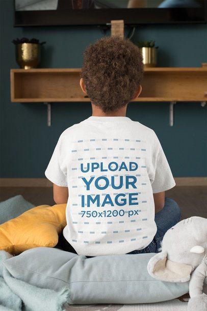 Back-View T-Shirt Mockup of a Kid Watching TV 31641