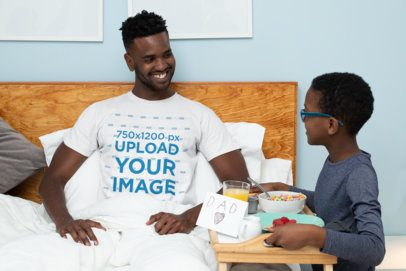 T-Shirt Mockup Featuring a Kid Serving Breakfast to His Dad 33101